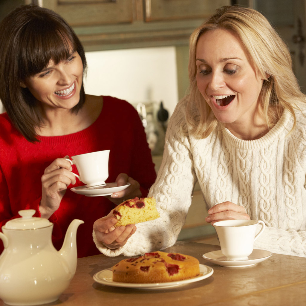 Mandatory Credit: Photo by Monkey Business Images/REX/Shutterstock (1938708a) MODEL RELEASED Two Middle Aged Women Enjoying Tea And Cake Together VARIOUS