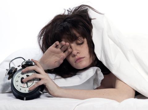 9-18-12-woman-in-bed-awakening-alarm-clock