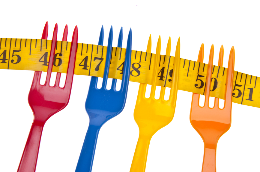 On A Diet Border or Background Image with Vibrant Forks, and a Measuring Tape Isolated on White with a Clipping Path.